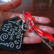 Hand holding Santa's key so you can get a sense of its size.