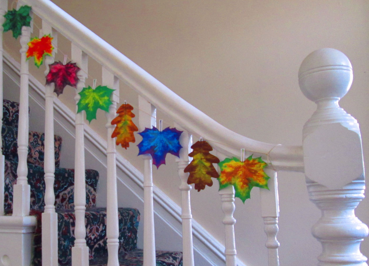 Paper Leaves Hanging from a Bannister
