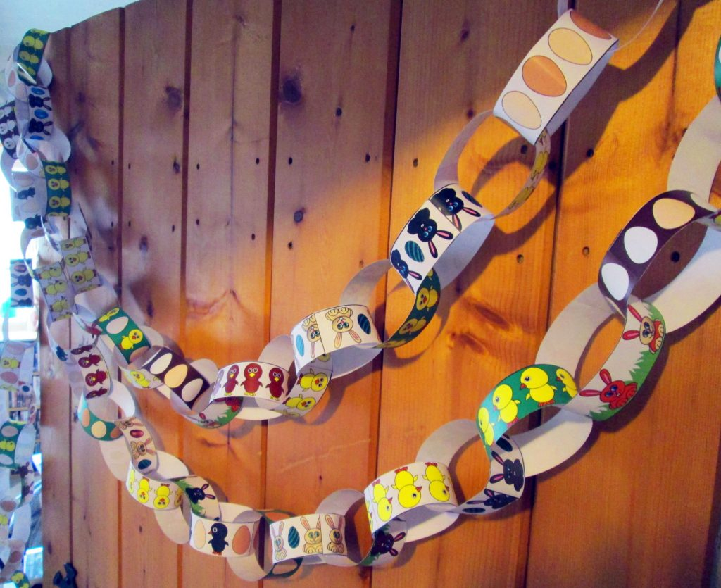 A line of our Easter paper chains linked together and hanging up.