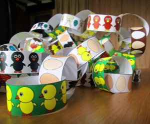 A pile of Easter Paper chains decorated with chicks and binnies - free to print out.