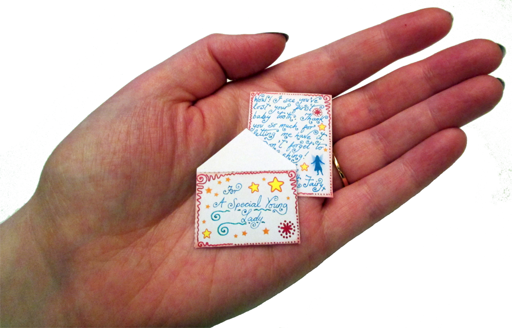 A miniature Tooth Fairy letter with a matching envelope for a little girl.