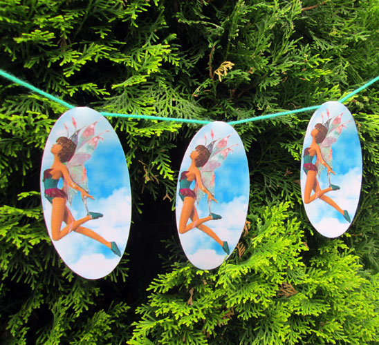 Pretty fairy bunting hanging in a garden