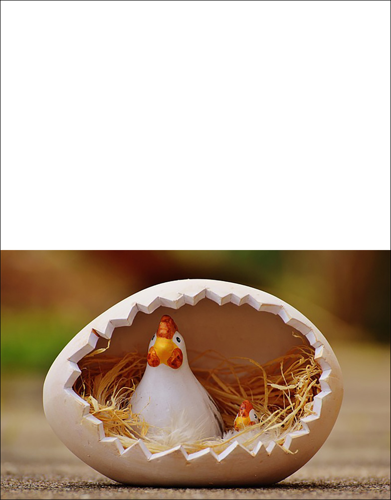A printable Easter card picturing a china hen and her chick inside an egg.