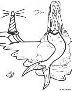 Free printable colouring page of a mermaid on a beach with a lighthouse in the background