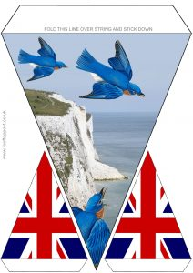 Bunting for VE Day with a decorative picture of bluebirds ove the White Cliffs of Dover
