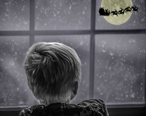 boy-watching-santa-claus-fly-past-his-house