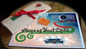 Letter from Santa tied with ribbon and pictured with matching envelope