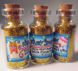 Bottles of fairy dust with pretty label.