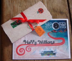 Santa letter tied with ribbon and name tag