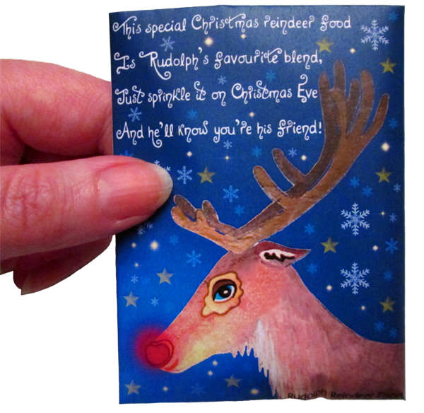 A hand holding a packet of food for Rudolph the reindeer